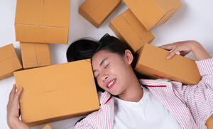 happy woman with packages because of growth driven design