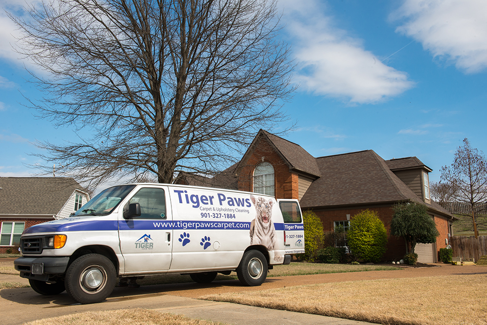 Tigerpaws Van in Front of House