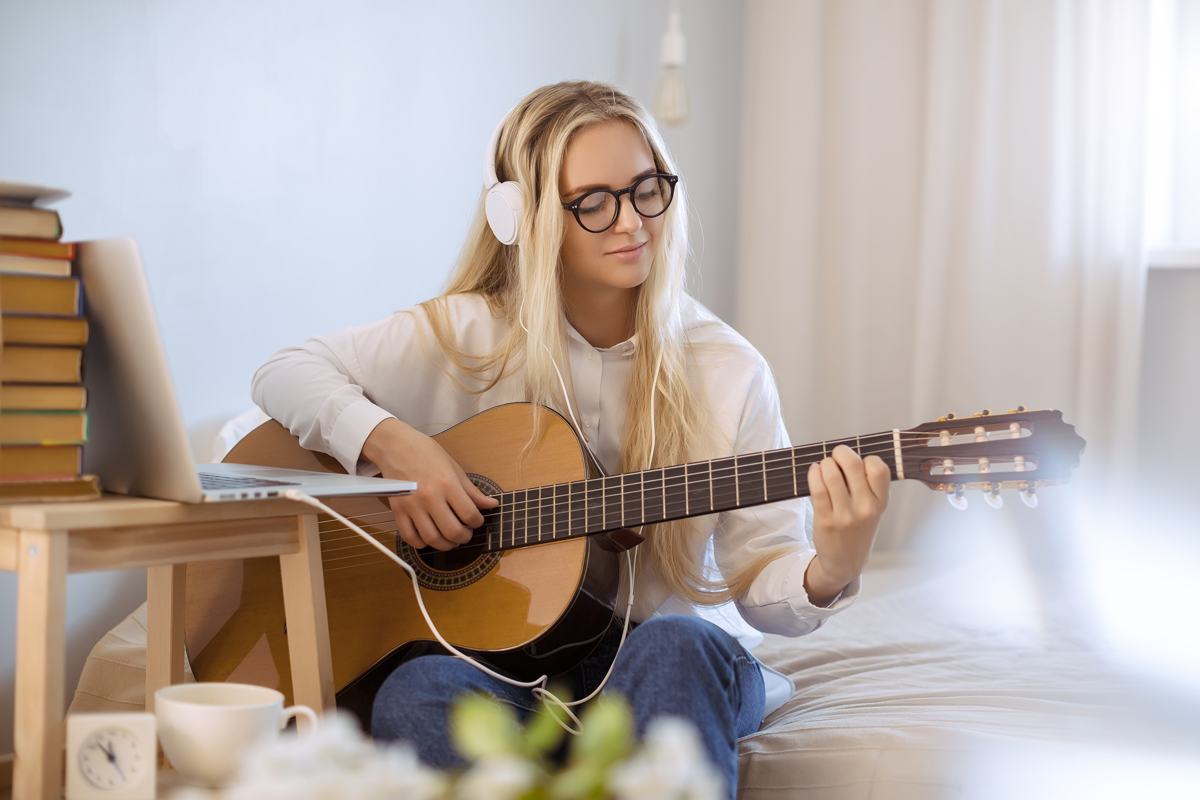 Female Playing Guitar at Home